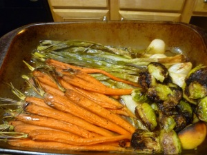 Roasted carrots, whole onion bulbs and brussel sprouts