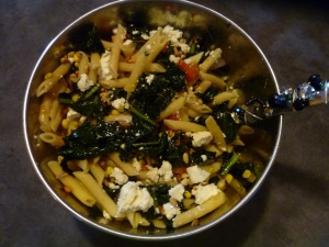 Pasta topped with sauted chard, fresh tomatoes, roasted pine nuts and feta.