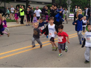 My older son leads his brother and cousin to the finish in the kids' 100 meter dash. Check out the tongue.