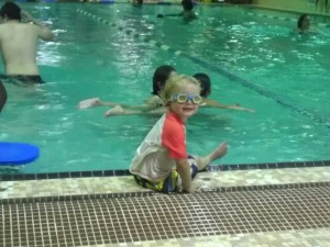 This little guy charmed his way into his siblings' swim class.