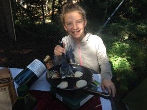 Granola Girl cooks up flapjacks on our propane stove